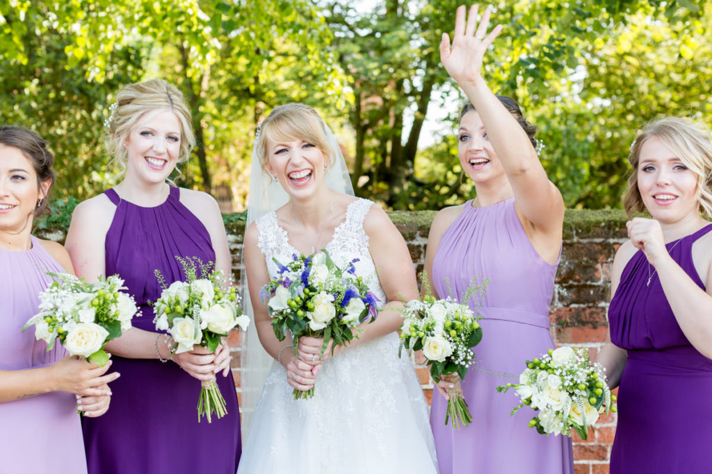 Bridesmaid waving