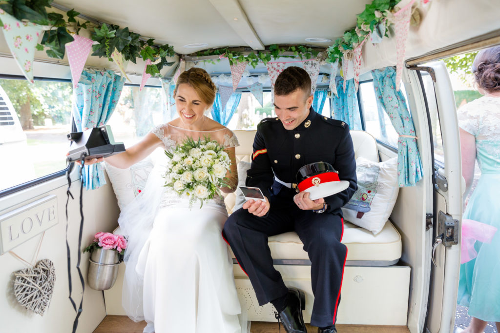 Bride and groom in VW camper