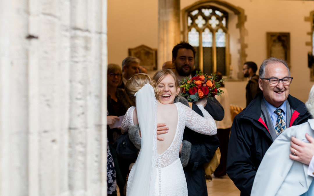 Bride and guest embracing at a wedding in Reading