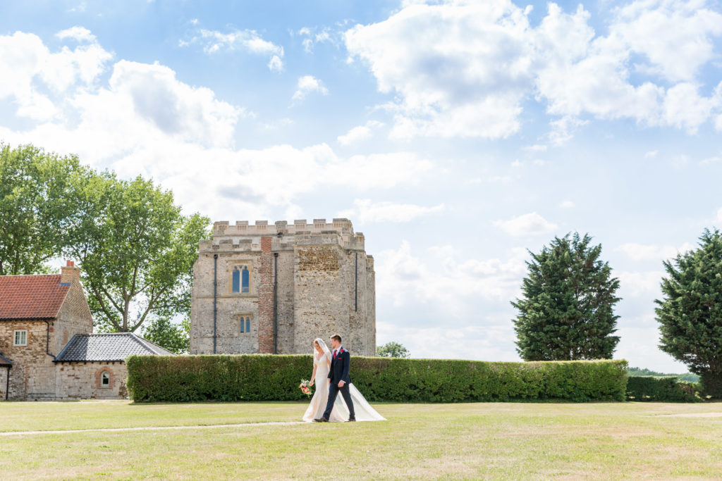 Bride and groom walking at Pentney Abbey