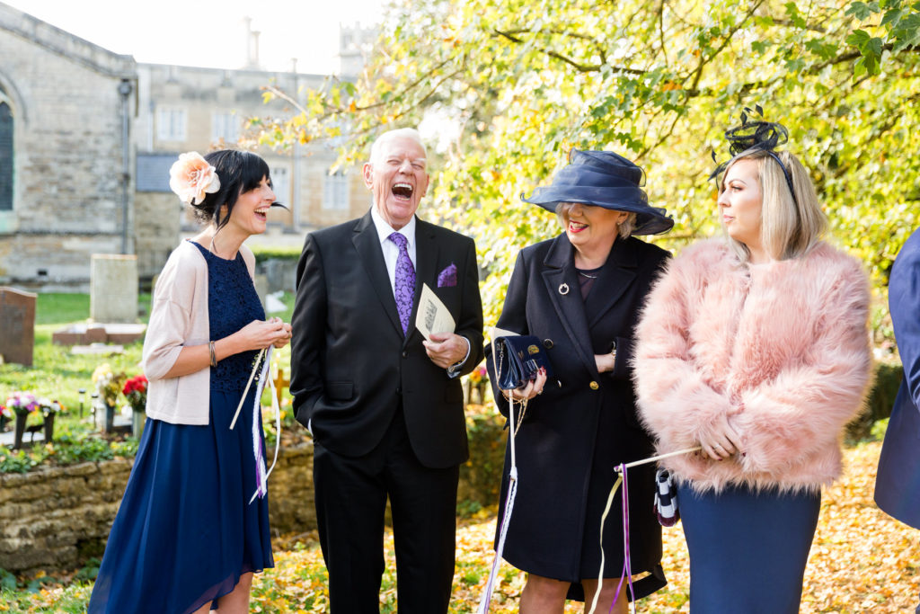 Man laughing at a wedding