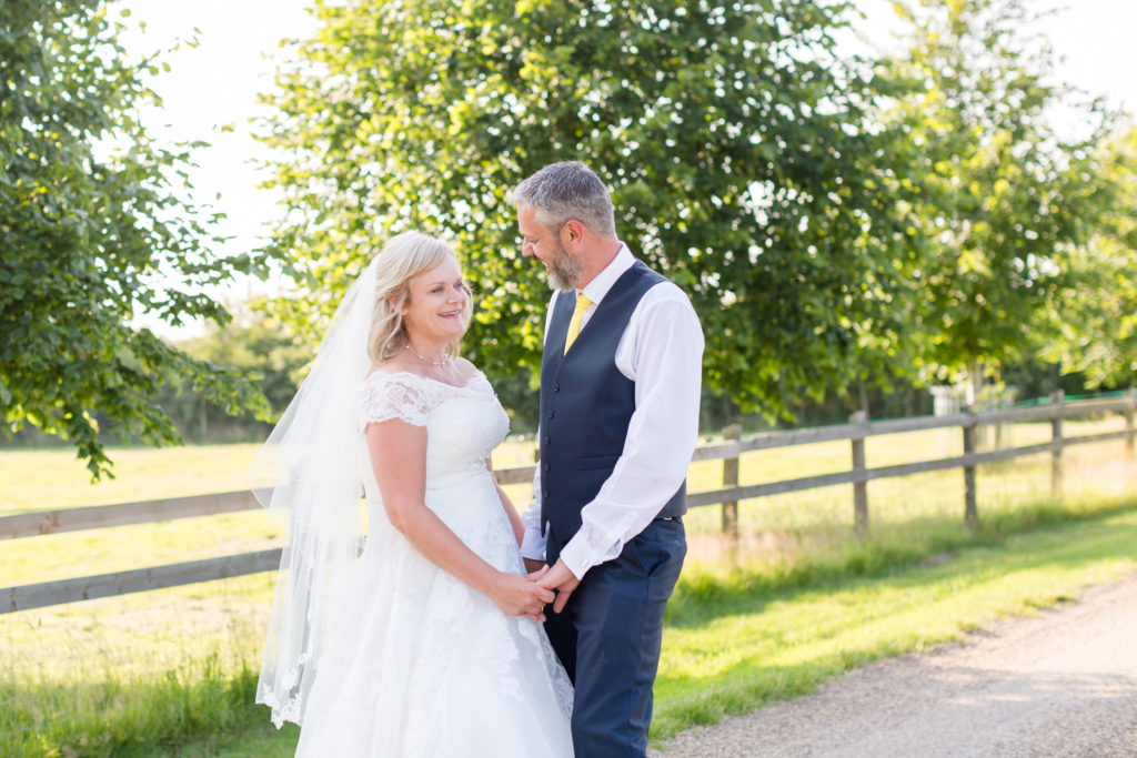 Godwick Hall Norfolk wedding couple in summer