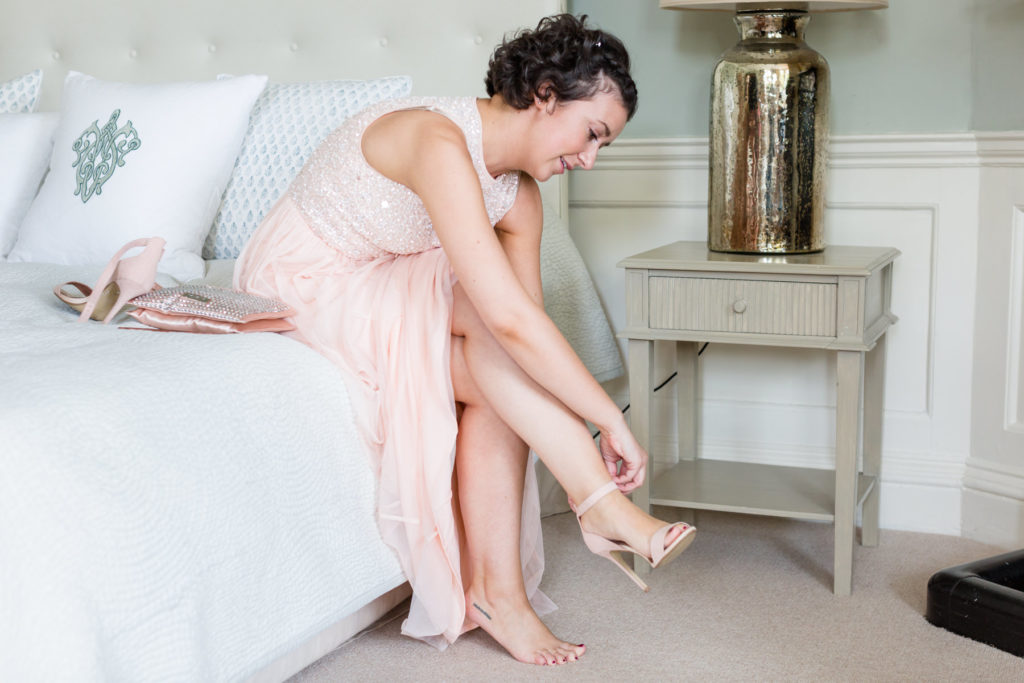 bridesmaid fastening her shoes