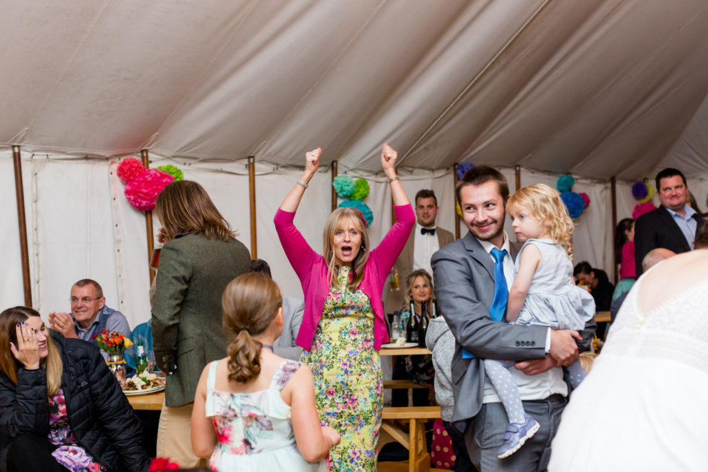Mother of the groom celebrating at a pub marquee wedding