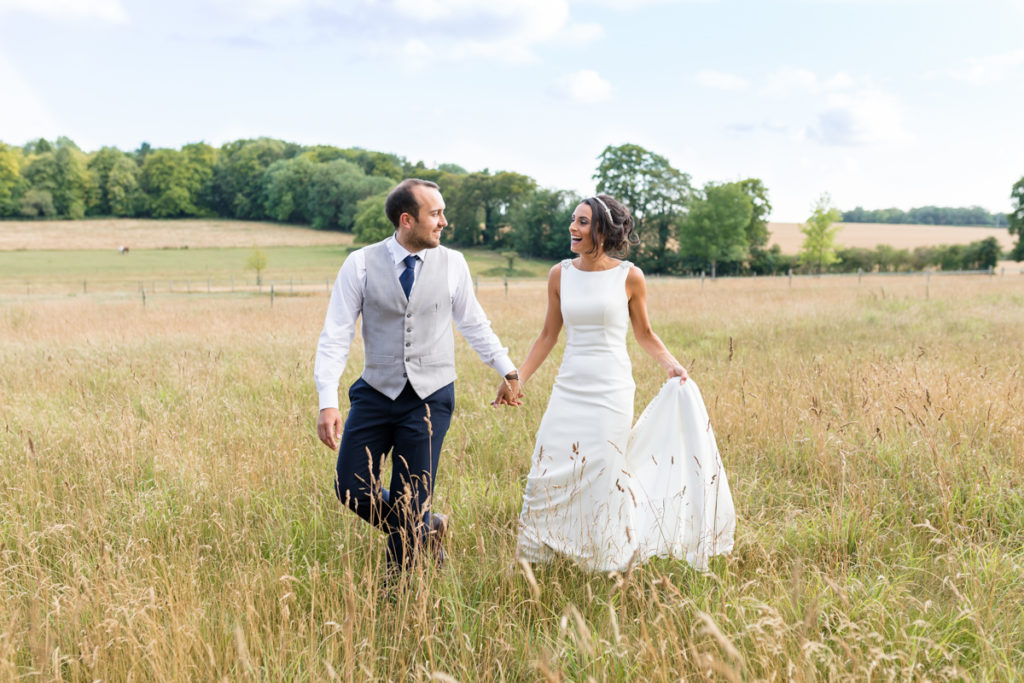 Bride and groom walking at Burloes Hall wedding