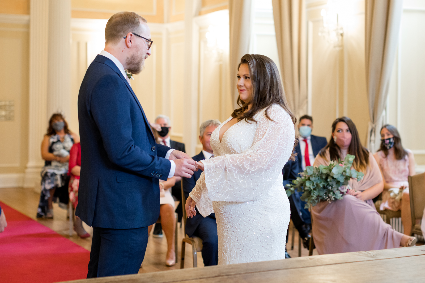Groom giving bride her ring at the Assemble House Norwich