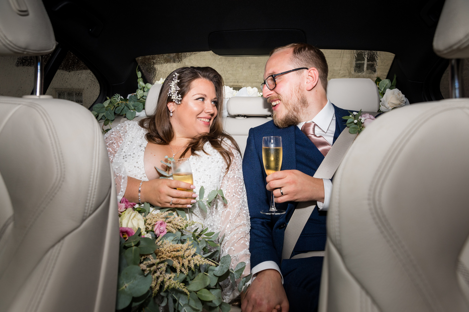 Bride and groom in the wedding car