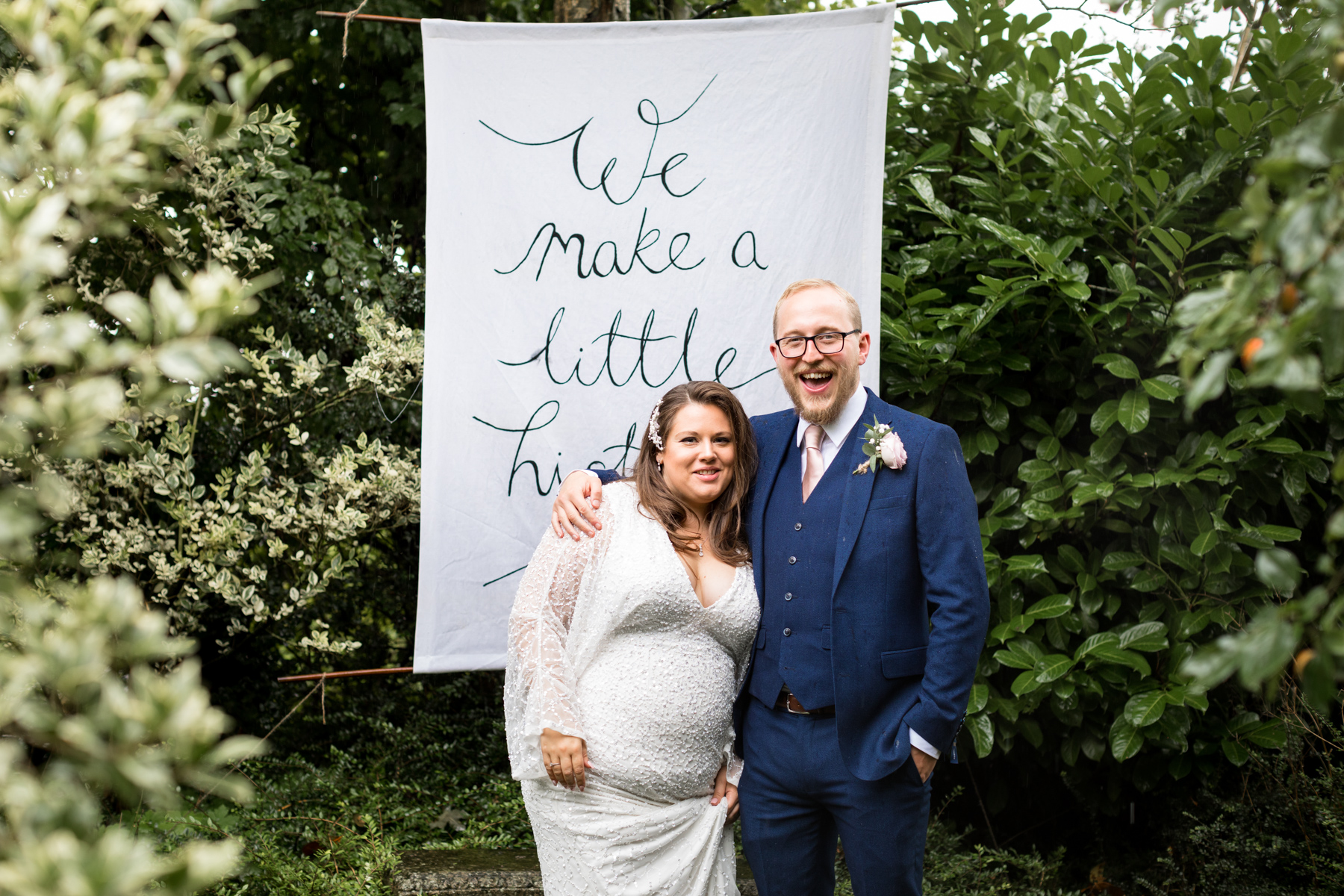 Bride and groom with banner