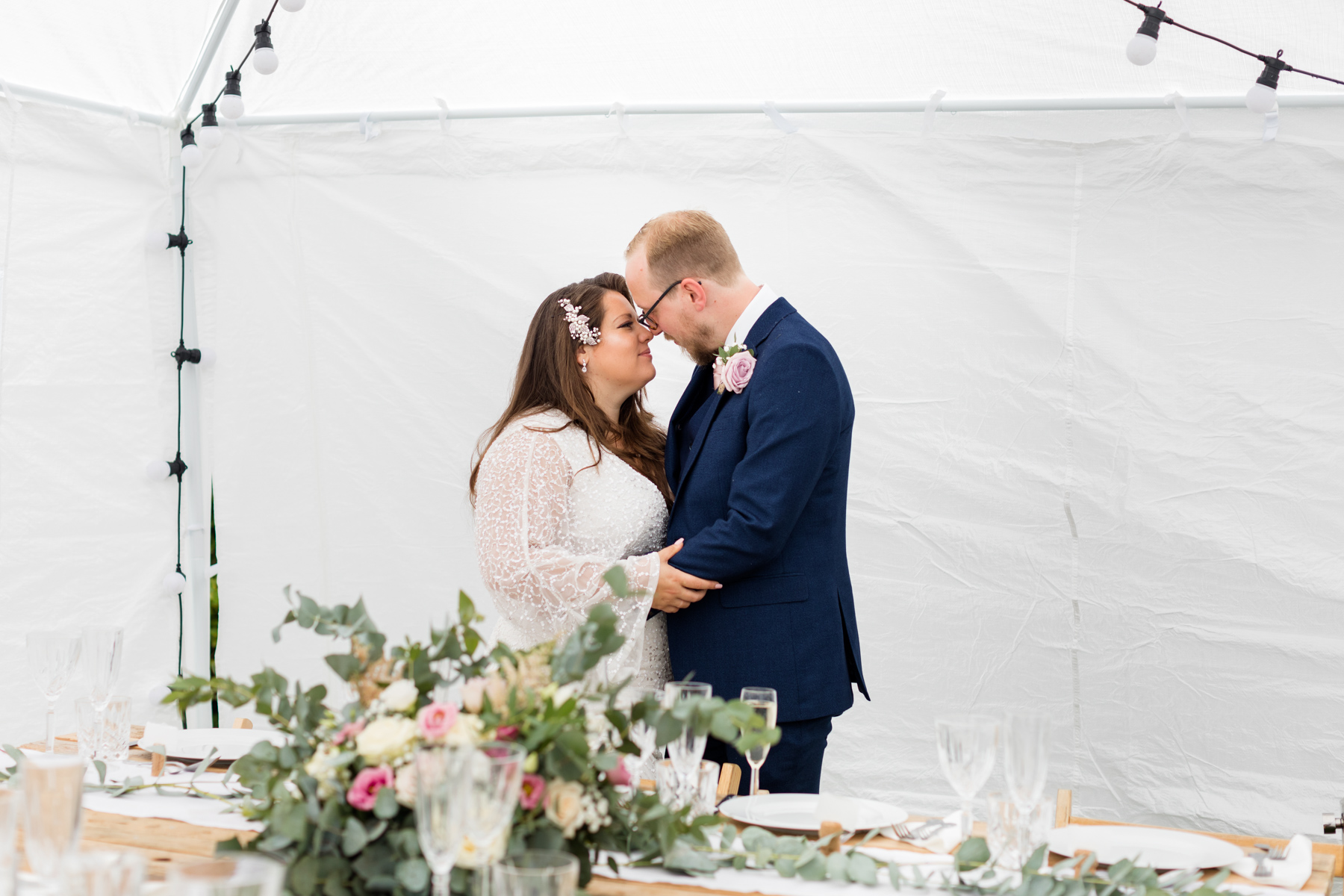 Bride and groom in marquee