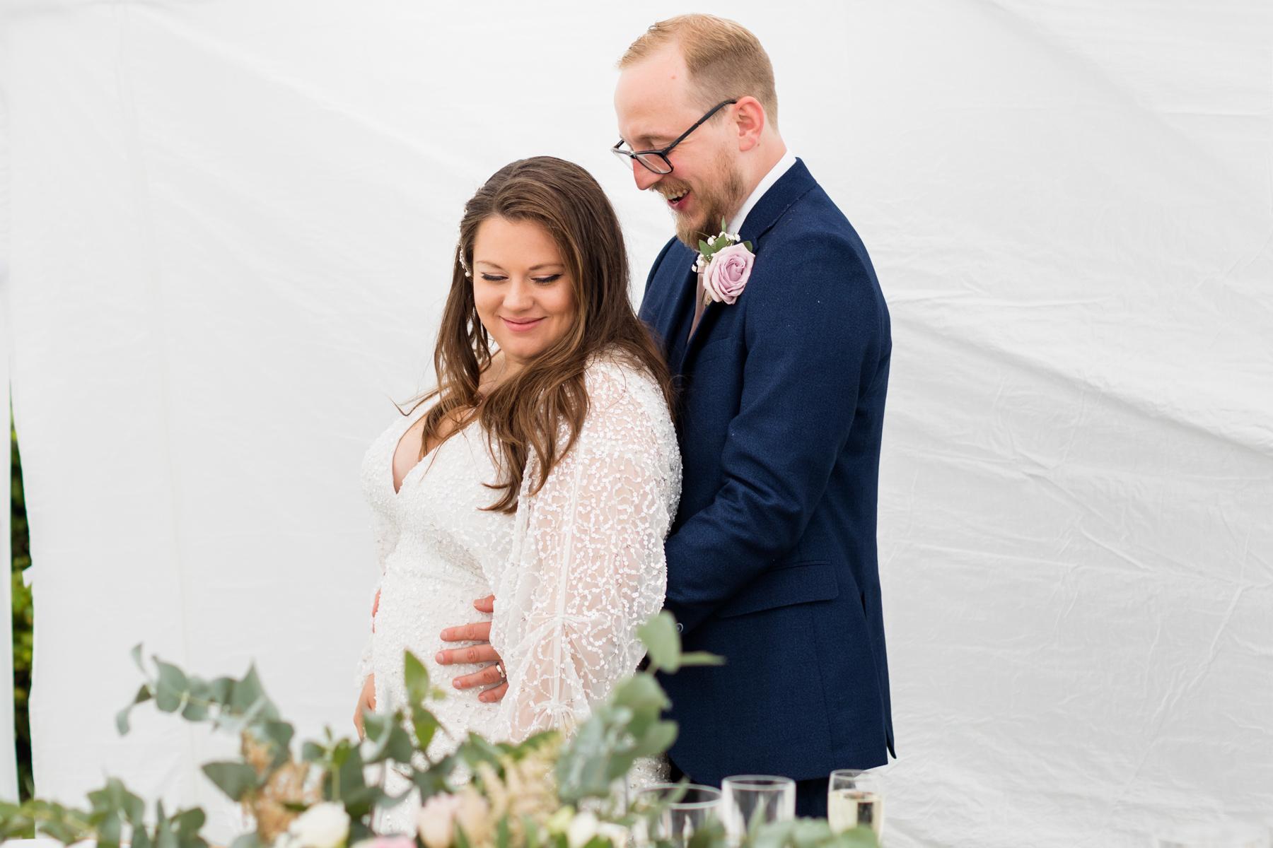Bride and groom in marquee in Norfolk