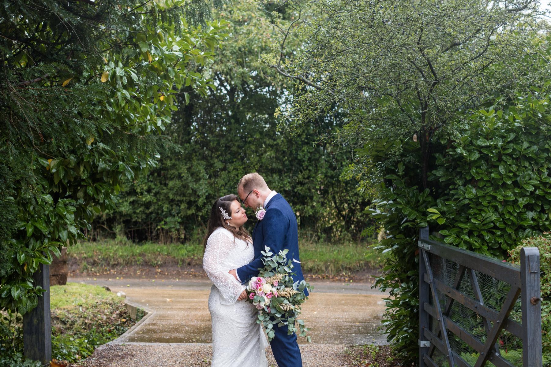 Bride and groom in gateway Norfolk