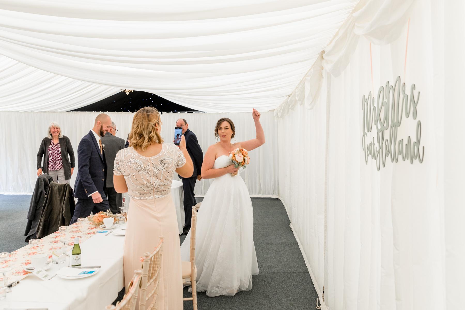 Bride entering reception marquee