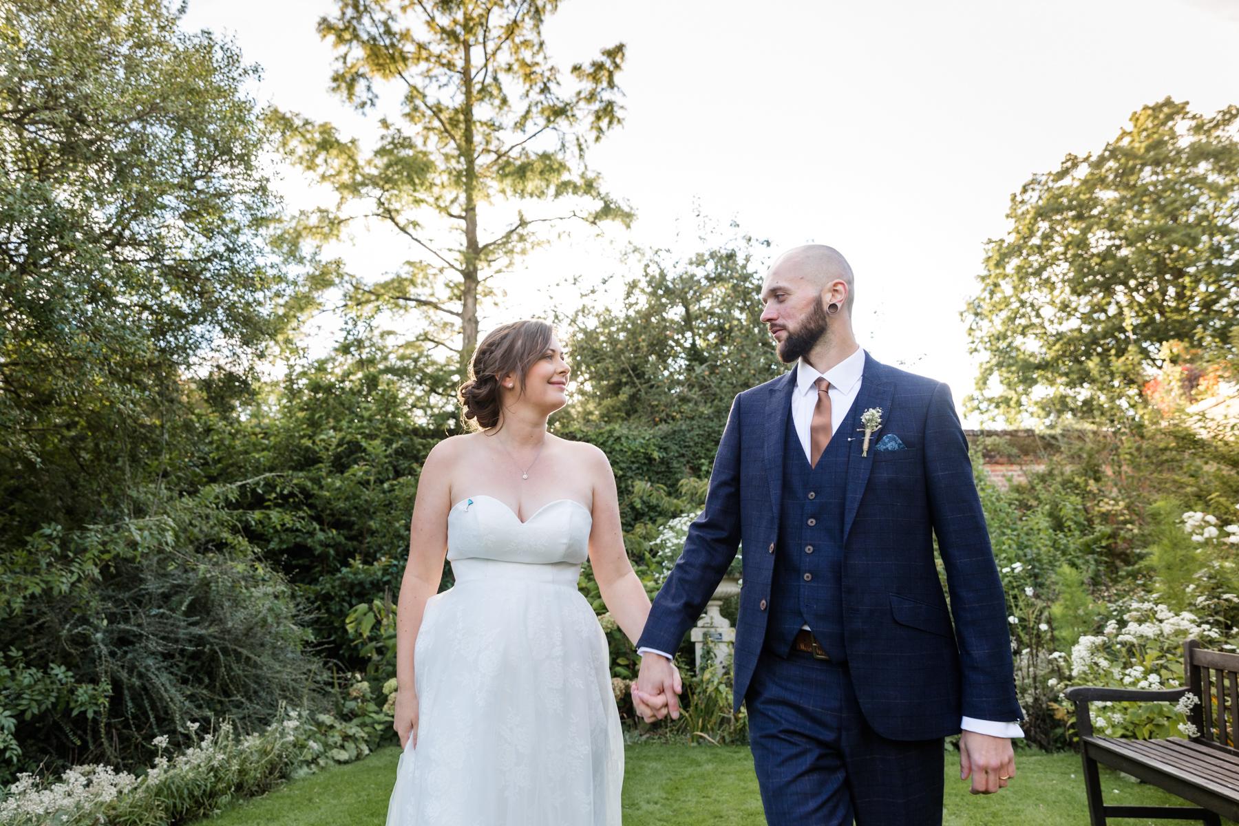 Deene Park white garden wedding couple walking