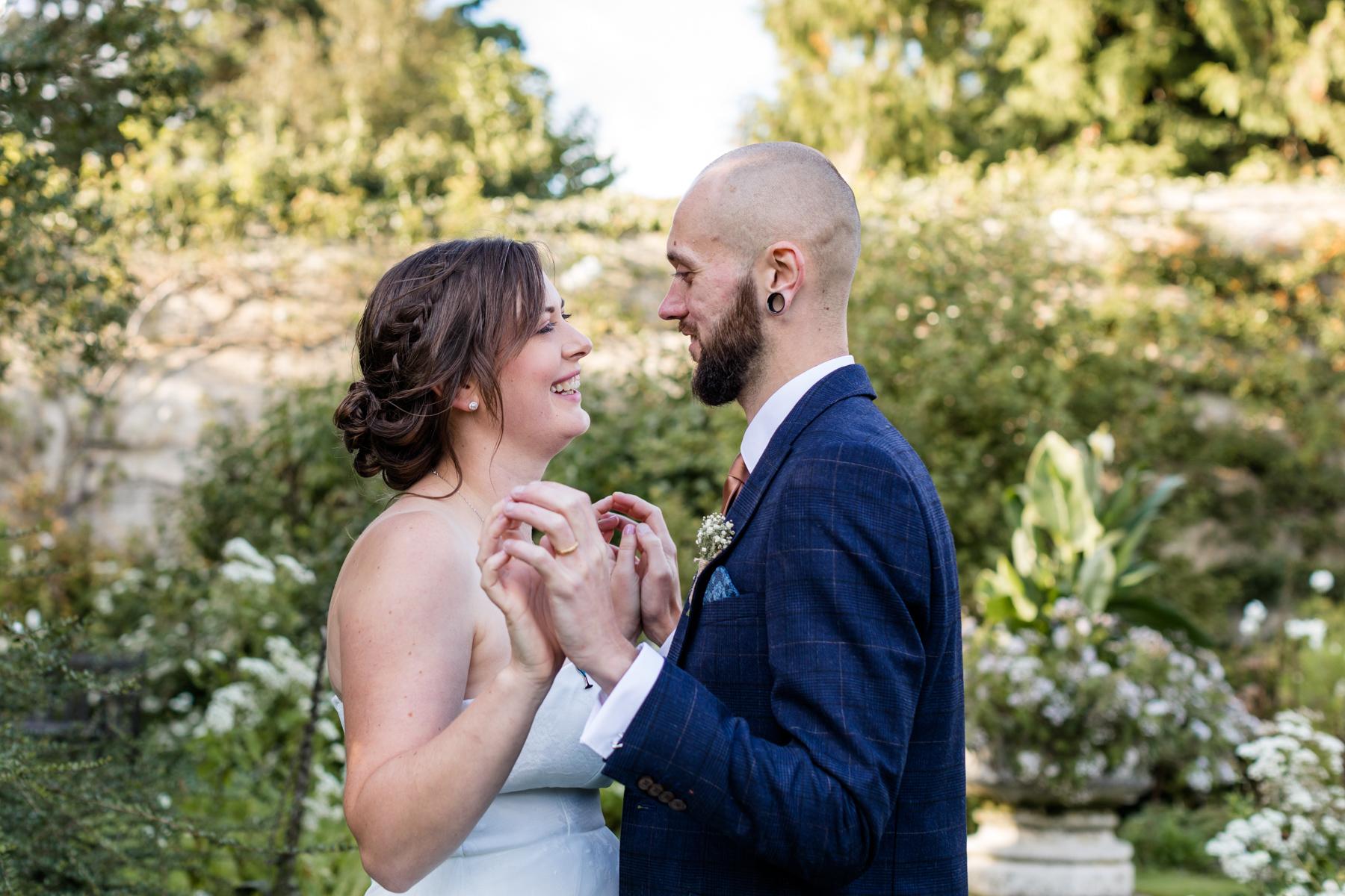 Deene Park white garden wedding holding hands