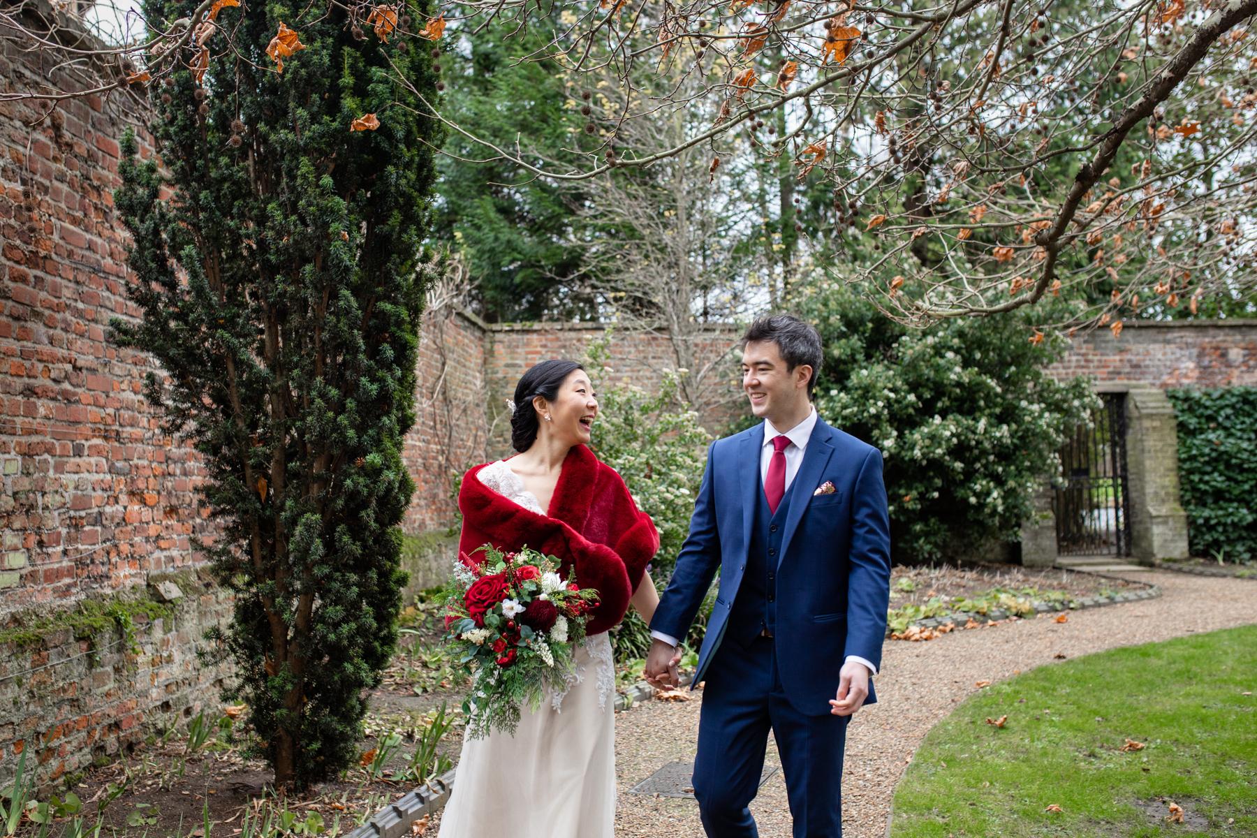 Bride and groom at Emmanual College Cambridge