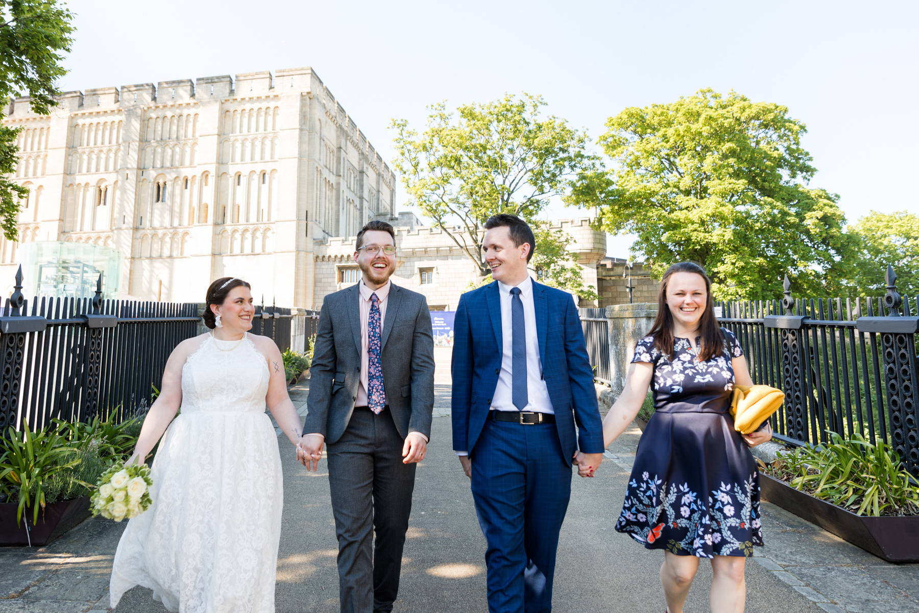 Bride and groom with friends outside Norwich Castle