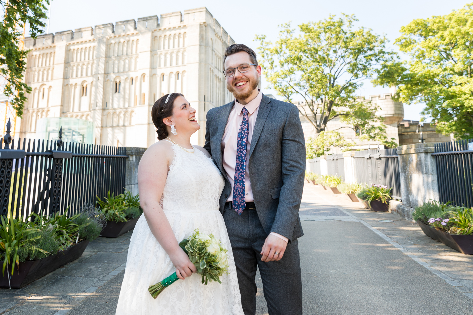 Bride and groom on Norwich Castle bridge