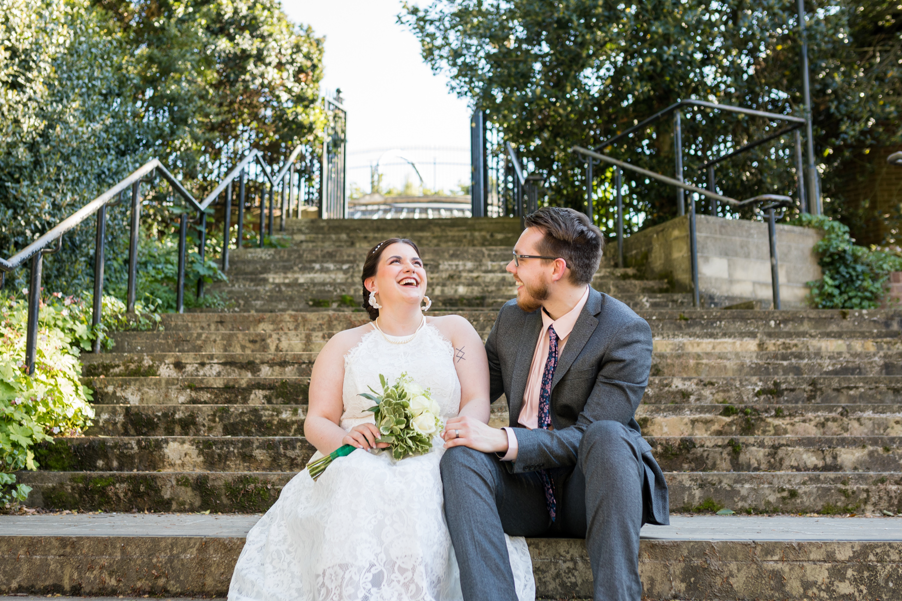 Bride and groom sitting on steps in Norwich